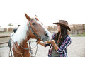 Cheerful Woman Cowgirl Playing With Horse In Countryside Royalty Free Stock Photo - 78357705