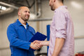 Auto Mechanic And Man Shaking Hands At Car Shop Stock Photos - 78423873
