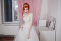 Red-haired Girl In A Wedding Dress, Bright Unusual Appearance, Red Nails, A Girl With Pale Skin Stock Images - 78432094