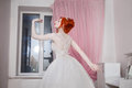 Red-haired Girl In A Wedding Dress, Bright Unusual Appearance, Red Nails, A Girl With Pale Skin Stock Image - 78432181