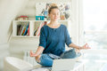 Portrait Of An Attractive Woman At Table , Lotus Pose Stock Images - 78491204
