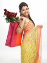 Woman With Bag Full Of Red Roses Royalty Free Stock Images - 7853279