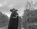 Black And White. The Girl In The Mask And Robes On The Dark Background Of The Sky Image To Halloween Royalty Free Stock Photography - 78505177