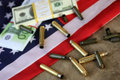 Bullet And Money On The American Flag Royalty Free Stock Photo - 78522045