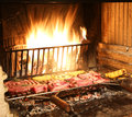 Hot Fire In The Fireplace In The Restaurant With Raw Meat Stock Photo - 78537180