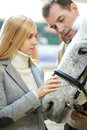 Couple And A Horse Stock Photo - 78542740