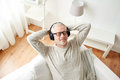Happy Man In Headphones Listening To Music At Home Royalty Free Stock Photos - 78557498