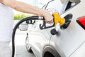 Person Holding Yellow Nozzle Filling Petrol Into Car Stock Photo - 78566210