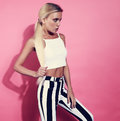 Sexy Blond Young Model Posing In Strip Trousers And White Short Royalty Free Stock Photos - 78573768
