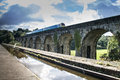 Langollen Canal At Chirk Train Passes On Viaduct Royalty Free Stock Photo - 78577315
