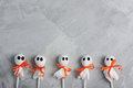 Halloween Lollipop Ghosts On Gray Concrete Background Stock Photography - 78581842