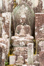 Weather Took Its Toll On This Sitting Bhudda Statue. Royalty Free Stock Photos - 78585048