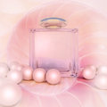 Perfume In A Glass Bottles And Pearl Beads On Pink. Stock Photo - 78597550