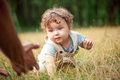 The Little Baby Or Year-old Child On The Grass In Sunny Summer Day. Stock Images - 78604074