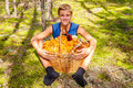 Happy Teen Boy Sits In The Autumn Woods With A Big Basket Of Cha Stock Photos - 78627233