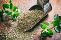 Fresh And Dried Oregano On A Wooden Table Royalty Free Stock Photos - 78634298