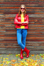 Beautiful Woman Wearing A Red Jacket And Rubber Boots In Autumn Style Near Yellow Leafs Royalty Free Stock Photography - 78645347