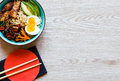 Japanese Noodles Bowl With Chicken, Carrots, Avocado Stock Photography - 78649752