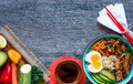 Japanese Noodles Bowl With Chicken, Carrots, Avocado Royalty Free Stock Photos - 78649788