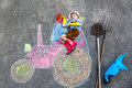 Little Kid Boy Having Fun With Tractor Chalks Picture Stock Photo - 78661120