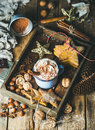 Mug Of Hot Chocolate, Gingerbread Cookies, Nuts In Wooden Tray Stock Photos - 78670213