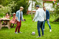 Happy Friends Playing Football At Summer Garden Stock Images - 78672654