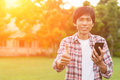 Happy Asian Man With News Or Message From Smart Phone In Garden, Stock Photos - 78678083