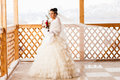 Happy Bride With Bouquet Waiting For Groom In Winter Wedding Day Royalty Free Stock Photography - 78681717