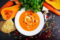 Smooth Butternut Squash And Carrot Soup With Cream, Pumpkin Seeds Goji Berries Stock Photography - 78691232