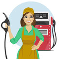 Gas Station Female Worker Holding Petrol Pump Standing Next To Fuel Dispenser Royalty Free Stock Image - 78698926