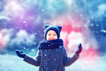 Cute Happy Kid Under The Snow In Winter Park Royalty Free Stock Photos - 78717198