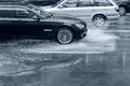 Car Driving On Flooded Road With Splashing Water After Heavy Rai Royalty Free Stock Images - 78717399