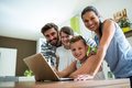 Portrait Of Happy Family Using Laptop In The Living Room Stock Images - 78717704