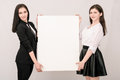 Two Happy Smiling Young Business Women Carrying Big Blank Signbo Stock Photos - 78722983