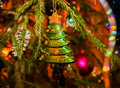 Christmas Toy Christmas Tree Hanging On Green Spruce Branch. Stock Photos - 78743393