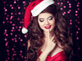Surprised Santa Girl With Finger On Lips. Beautiful Smiling Woma Stock Images - 78743874