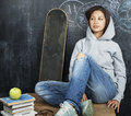 Young Cute Teenage Girl In Classroom At Blackboard Seating On Table Smiling Stock Image - 78763311