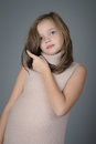Portrait Of A Cute Little Girl Pushes Her Hair From Her Face. Stock Photos - 78798033