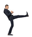 Young Businessman Kicking Someone Or Something Isolated On A White Background Stock Photography - 78799182