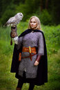 Girl In Chain Mail Holding Owl In Forest Stock Image - 78860951