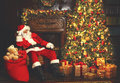 Santa Tired Asleep In Chair Near Christmas Tree Stock Images - 78891904