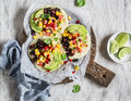 Spicy Bean Tostadas With Corn Salsa And Avocado  On A Light Background, Top View. Royalty Free Stock Image - 78901186