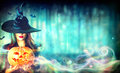 Sexy Witch With A Halloween Pumpkin Jack-o-lantern Royalty Free Stock Photo - 78908305
