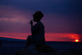 Female Silhouette With Wine On Sunset Royalty Free Stock Photo - 78918405