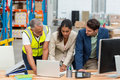 Warehouse Managers And Worker Discussing With Laptop Stock Image - 78919151