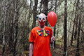 Scary Evil Clown In The Woods Royalty Free Stock Photography - 78925627