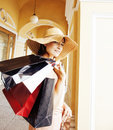 Young Pretty Smiling Woman In Hat With Bags On Shopping At Store Royalty Free Stock Images - 78934629