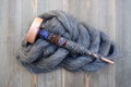 Wood Drop Spindle On A Pile Of Wool Roving Twisted With Yarn Royalty Free Stock Photos - 78938308