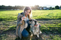 Unrecognizable Pregnant Woman With Dog In Green Sunny Nature Royalty Free Stock Photo - 78941835