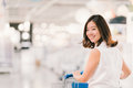 Beautiful Young Asian Woman Smiling, With Shopping Cart, Shopping Center Or Department Store Scene, Blur Bokeh Background Stock Images - 78942734
